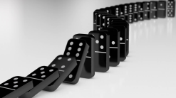 black-dominoes-falling-in-chain-reaction_mkdg2gv9__f0000